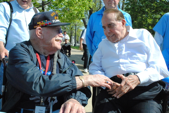 Floyd Woods, 92, of Boulder City extends his hand to former U.S. Sen. Bob Dole, who played an instrumental role in establishing the World War II Memorial. Woods served in the South Pacific with th ...
