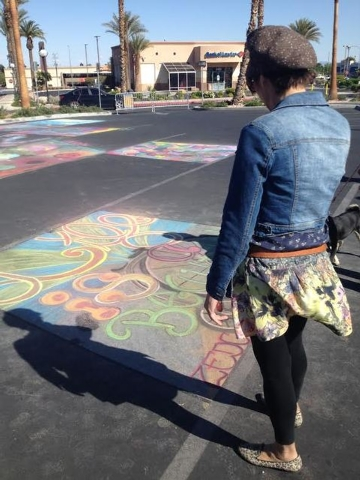 Nikki J. Sands, a featured artist at Arts, Eats & Beats, contemplates chalk art at the Village Square event, March 30. The open-air shopping center at 9400 W. Sahara Ave. co-hosted the event with  ...