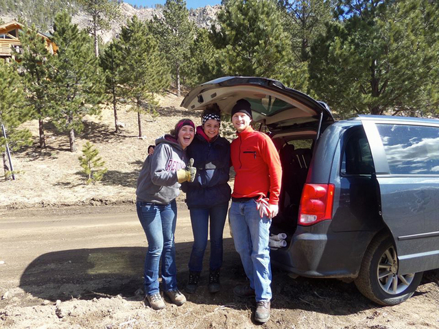 Hannah Litton, left, Gianna Zazzarino and Frank Garrison pose for a photo in Big Elk Meadows, Colorado. Student volunteers from the University of Redlands spent their 2014 spring break in Boulder, ...