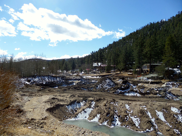 The small lake in Big Elk Meadows, Colorado shows what is left of the dam that was washed out. Frank Garrison and 25 other students spent their spring break in Boulder, Colorado to help families a ...