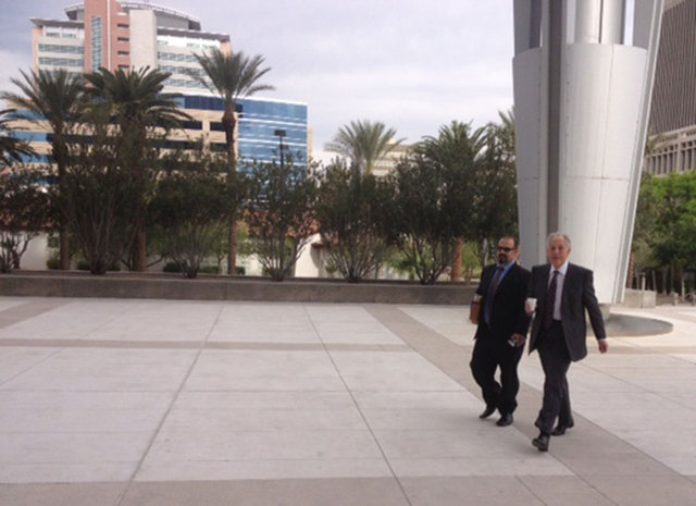Las Vegas escort service operator Emmanouil Varagiannis, left, arrives at the federal courthouse in Las Vegas on Wednesday with his lawyer, Richard Wright, before pleading guilty to a tax-evasion  ...