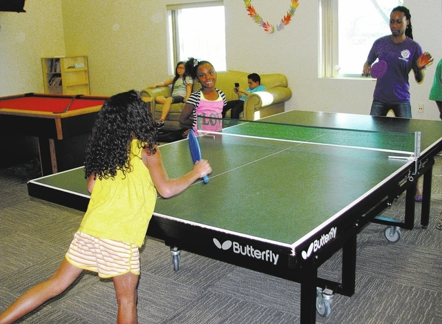 Program assistant Carlinda Ford instructs after-school program participant Sofia Galleo in table tennis in March 2010 at the Hollywood Recreation and Community Services Center, 1650 S. Hollywood B ...