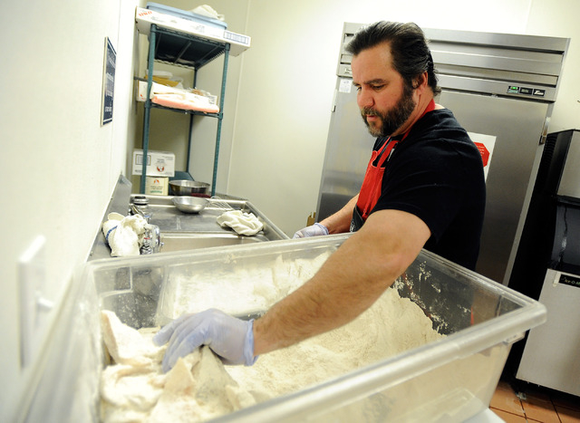 Dave Zrebiec prepares pieces of fish with batter before they are fried during the weekly fish fry at St. Viator Catholic Church on Friday, March 28, 2014. (David Becker/Las Vegas Review-Journal)