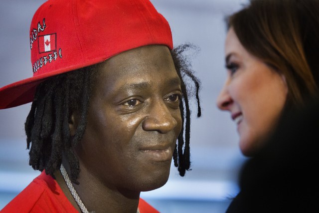 Rapper Flavor Fav,left, after appearing  in Clark County  District Court on Monday, April 14,2014. To the right is his attorney Kristina Wildveld.  The artist, whose real name is William Drayton,  ...