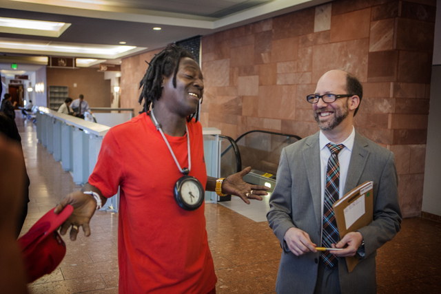 Rapper Flavor Fav, left, after appearing  in Clark County District Court on Monday, April 14,2014.  On the right is his attorney Dayvid Figler. The artist, whose real name is William Drayton, plea ...