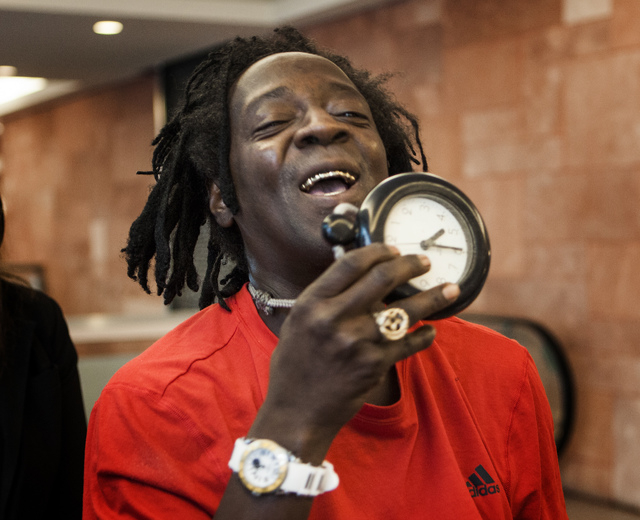 Rapper Flavor Fav, show his clock  after appearing  in Clark County District Court on Monday, April 14,2014. The artist, whose real name is William Drayton, pleaded guilty to domestic violence cha ...