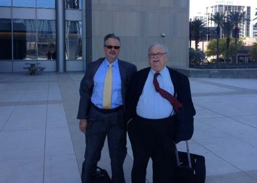 Defense lawyers Osvaldo Fumo, left, and Thomas Pitaro, right, are shown as they are about to enter the Lloyd George Federal Courthouse on Tuesday. (Jeff German/Las Vegas Review-Journal)