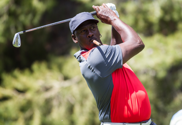Michael Jordan tees off at the 8th hole during the Michael Jordan Celebrity Invitational at Shadow Creek Golf Course in North Las Vegas on Saturday, April 5, 2014. (Chase Stevens/Las Vegas Review- ...