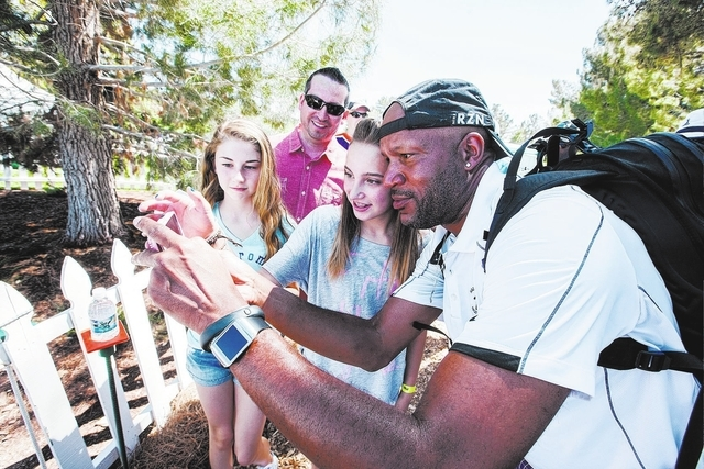 Former NBA player Ron Harper takes a selfie with 13-year-old Mckenzie Manzanares as 12-year-old Felicity Reimann looks on near the 18th hole on the final day of the Michael Jordan Celebrity Invita ...