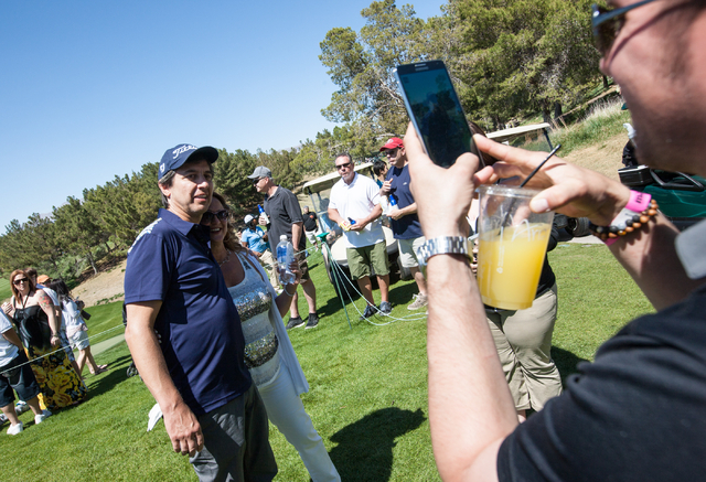 Actor and comedian Ray Romano poses for a photo with a fan at the 13th hole on the final day of the Michael Jordan Celebrity Invitational at Shadow Creek Golf Course in North Las Vegas on Sunday,  ...