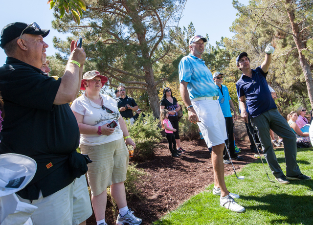 Actor and comedian Ray Romano, far right, talks with former NBA player Toni Kukoc at the 13th hole on the final day of the Michael Jordan Celebrity Invitational at Shadow Creek Golf Course in Nort ...