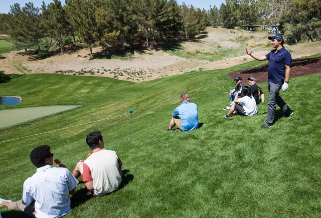Actor and comedian Ray Romano remarks to the crowd about his tee shot at the 13th hole on the final day of the Michael Jordan Celebrity Invitational at Shadow Creek Golf Course in North Las Vegas  ...