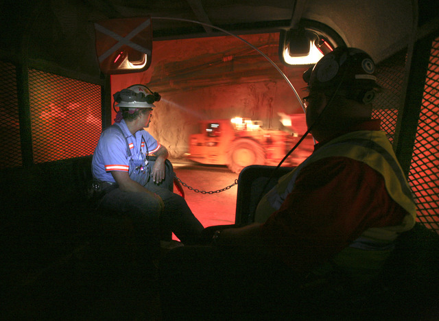 Miner Vern Goglio, left, and Lou Schack, director of communications for Barrick Gold Corp., ride in a truck in the Cortez Hills underground mine, located about 70 miles southwest of Elko, Nevada W ...
