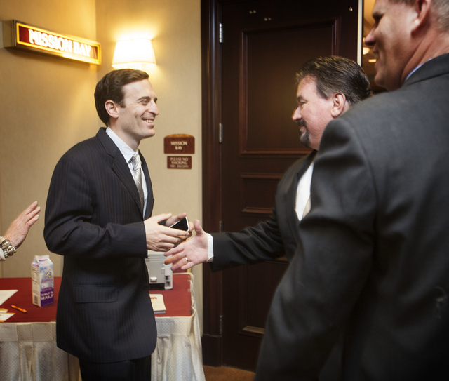 Adam Laxalt, left, grandson of former U.S Senator Paul Laxalt, (R)  chats with Nevada Republican Party Chairman Michael J. McDonald at the South Point hotel-casino on  Friday, April 11, 2014. This ...