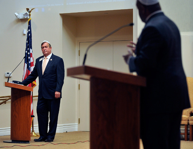 Assemblyman Cresent Hardy, R-Mesquite, left, listens as  Niger Innis speaks during a debate at Temple Beth Sholom on Tuesday, April 29, 2014. The two congressional candidates are competing to win  ...