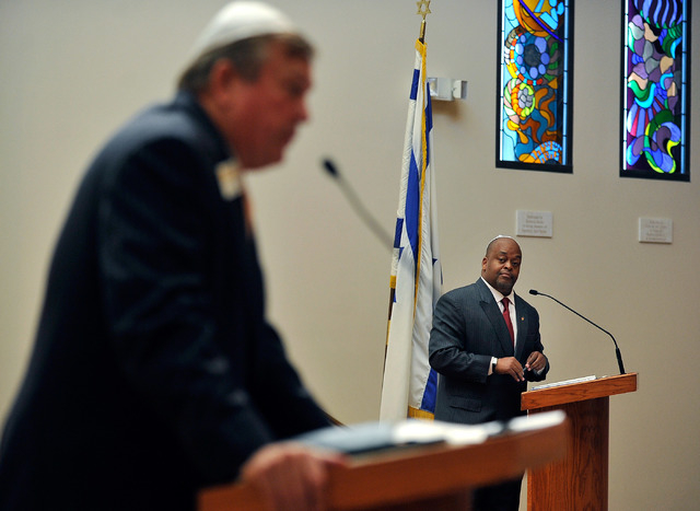Niger Innis, right, listens as Assemblyman Cresent Hardy, R-Mesquite speaks during a debate at Temple Beth Sholom on Tuesday, April 29, 2014. The two congressional candidates are competing to win  ...