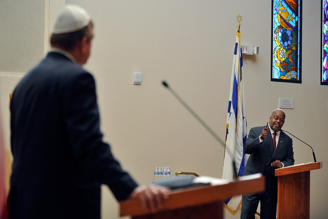 Assemblyman Cresent Hardy, R-Mesquite, left, listens as Niger Innis speaks during a debate at Temple Beth Sholom on Tuesday, April 29, 2014. The two congressional candidates are competing to win t ...