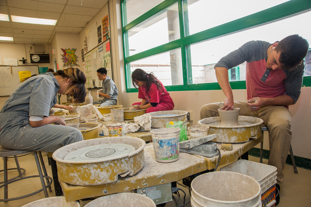 Green Valley High School students, from left, Cherie Diaz, 17, Matthew Chen, 17, Stephanie Sarabia, 17, and Manhal Jadid, 17, wheel throw clay bowls during their Ceramics 1 class at Green Valley H ...