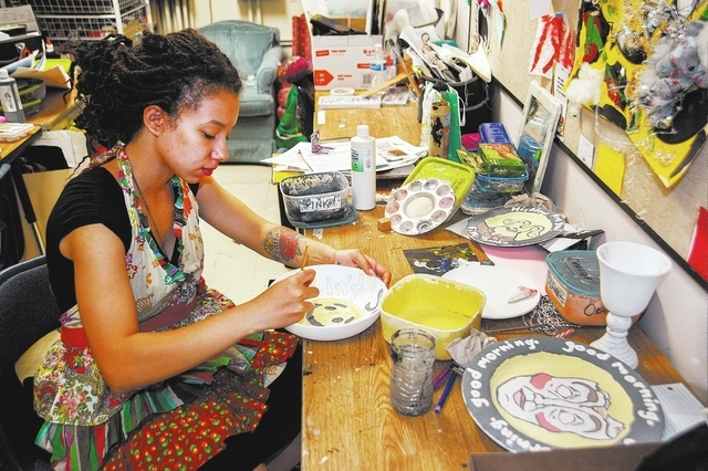 Green Valley High School student Gabbi Jones, 16, hand paints a clay bowl during her Studio Art class at Green Valley High School in Henderson, Nev., Friday, March 21, 2014. (Martin S. Fuentes/Las ...