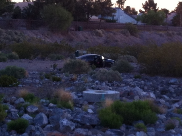 A driver crashed through a fence at Windmill and Green Valley parkways about 5:30 a.m. Thursday and landed in the Pittman Wash, Henderson police said. (Michael Quine/Las Vegas Review-Journal)