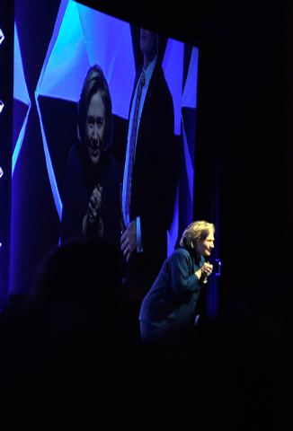 Former Secretary of State Hillary Clinton looks into the reacts after a person threw an object at her while speaking during The Institute of Scrap Recycling Industries' annual conference at the Ma ...