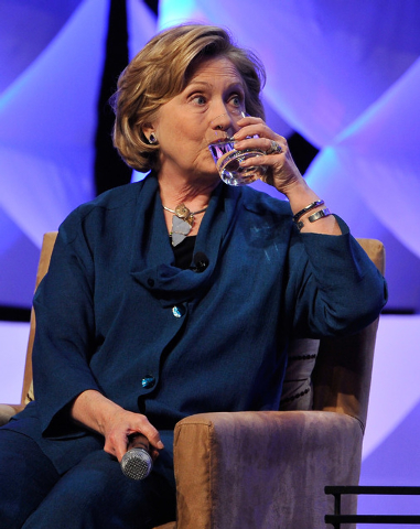 Former Secretary of State Hillary Clinton sips water as she answers questions during the Institute of Scrap Recycling Industries' annual conference at the Mandalay Bay hotel-casino on Thursday, Ap ...