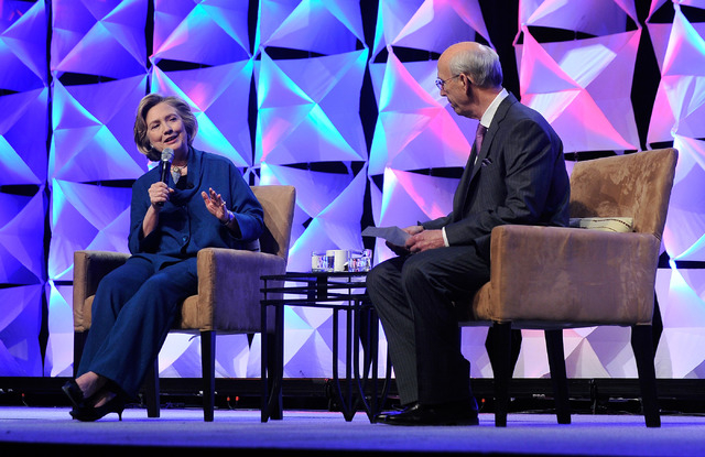 Former Secretary of State Hillary Clinton speaks with Jerry Simms, chairman of the Institute of Scrap Recycling Industries' during ISRI's annual conference at the Mandalay Bay hotel-casino on Thur ...