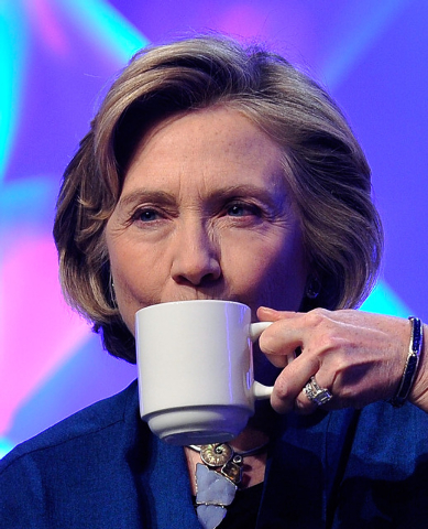 Former Secretary of State Hillary Clinton takes a sip as she speaks during the Institute of Scrap Recycling Industries' annual conference at the Mandalay Bay hotel-caisno on Thursday, April 10, 20 ...