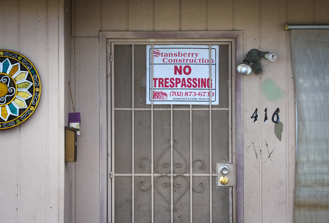 A No Trespassing notice is posted on one of the fire-damaged homes at 416 Princeton St. on Wednesday, April 23, 2014. Las Vegas Fire Department responded about 1:30 a.m. Wednesday to a fire outsid ...