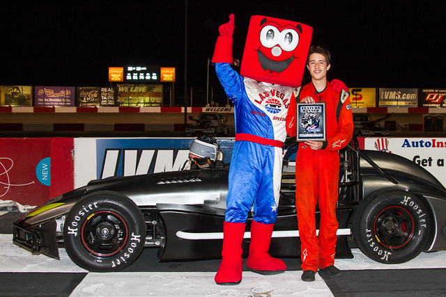 Ian Anderson poses in Victory Lane with his Thunder Car and Las Vegas Motor Speedway mascot Pit Boss following his second win of the season at the Bullring on Saturday night. (Jeff Speer/Las Vegas ...