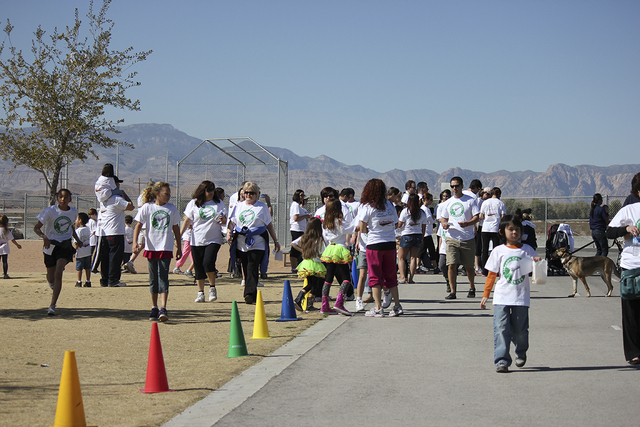 Walkers participate in the inaugural Blast Off for a Cure walk at Ries Elementary School, 9805 Lindell Road, in 2013. This year's walk is set for May 3 to benefit the Nevada Childhood Cancer Found ...