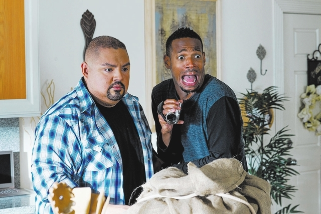 "Marlon Wayans, right, is shown in a scene with Gabriel Iglesias in ""A Haunted House 2,"" which Wayans wrote, produced and starred in."