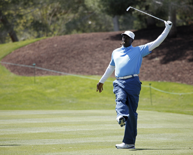 Michael Jordan reacts after hitting a shot in the Michael Jordan Celebrity Invitational at the Shadow Creek Golf Course in North Las Vegas, Nev. Thursday, April 3, 2014.  (John Locher/Las Vegas Re ...