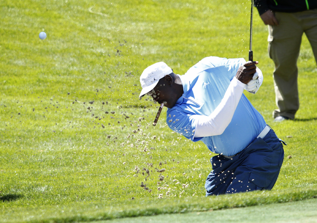 Michael Jordan hits out of a bunker during the Michael Jordan Celebrity Invitational at the Shadow Creek Golf Course in North Las Vegas, Nev. Thursday, April 3, 2014.  (John Locher/Las Vegas Revie ...