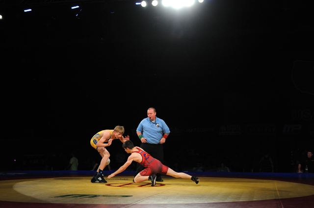 Trey Shores, left, wrestles his opponent Lain Gober during their match in the Asics Open Wrestling Championships at the Las Vegas Convention Center in Las Vegas Friday, April 18, 2014. (Erik Verdu ...