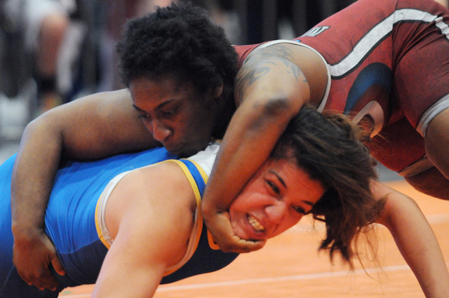Randi Miller, right, pins down her opponent Valerie Rosales during their match in the Asics Open Wrestling Championships at the Las Vegas Convention Center in Las Vegas Friday, April 18, 2014. (Er ...