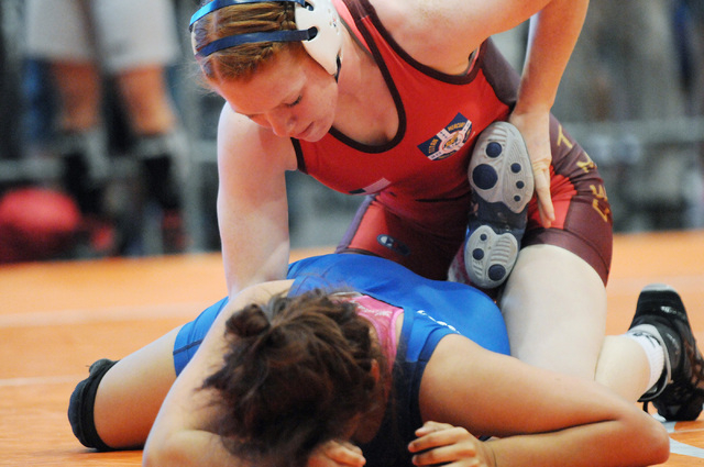 Jennifer Page, top, pins down her opponent Beatrice Martinez during their match in the Asics Open Wrestling Championships at the Las Vegas Convention Center in Las Vegas Friday, April 18, 2014. (E ...