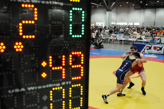 Patrick Smith, right, wrestles his opponent Anthonie Linares during their match in the Asics Open Wrestling Championships at the Las Vegas Convention Center in Las Vegas Friday, April 18, 2014. (E ...