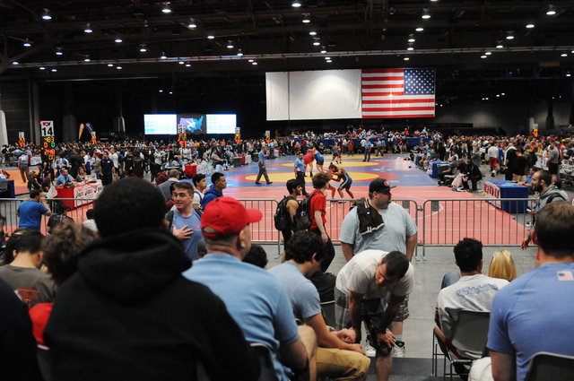 Spectators watch wrestling matches from the stands during the Asics Open Wrestling Championships at the Las Vegas Convention Center in Las Vegas Friday, April 18, 2014. (Erik Verduzco/Las Vegas Re ...