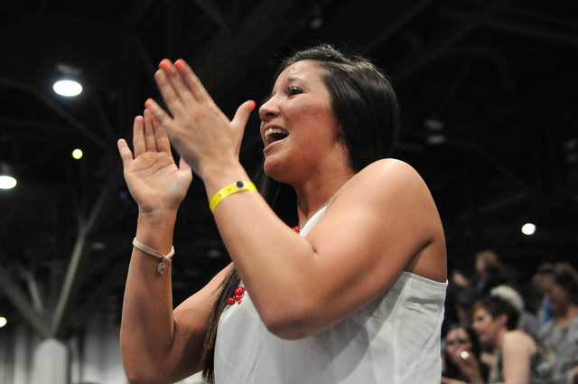 Candace Workman cheers for his boyfriend Nikko Triggas during his wrestling match in the Asics Open Wrestling Championships at the Las Vegas Convention Center in Las Vegas Friday, April 18, 2014.  ...