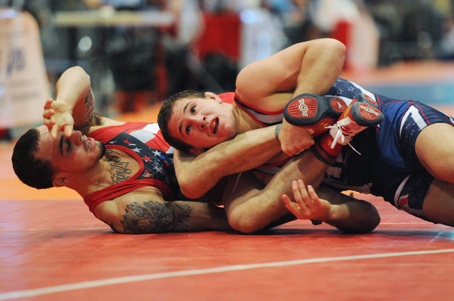Logan Stieber, right, pins down his opponent Jordan Oliver during their match in the Asics Open Wrestling Championships at the Las Vegas Convention Center in Las Vegas Friday, April 18, 2014. (Eri ...