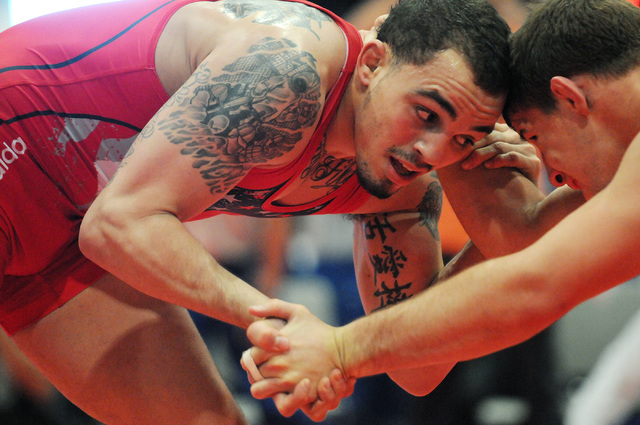 Jordan Oliver, left, wrestles his opponent Logan Stieber during their match in the Asics Open Wrestling Championships at the Las Vegas Convention Center in Las Vegas Friday, April 18, 2014. (Erik  ...