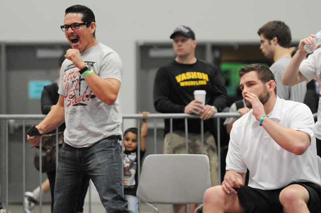 Coaches Ben Pagdilao, left, and Sam Wendland, yell in support of Pagdilao's son Christian during his match in the Asics Open Wrestling Championships at the Las Vegas Convention Center in Las Vegas ...