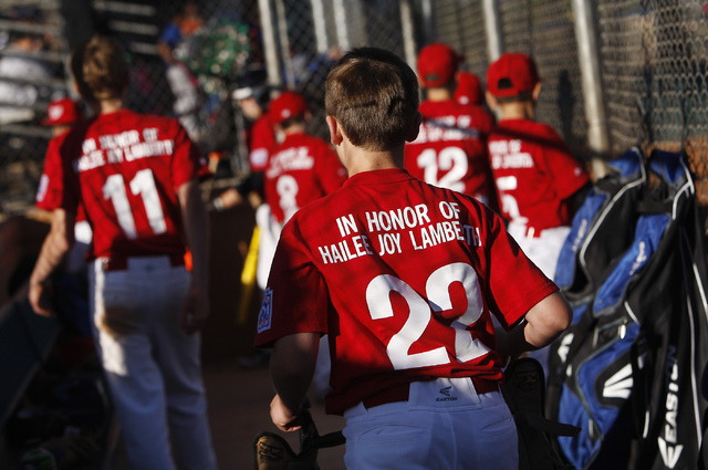 Cristian Dugger (22) and his Green Valley Nationals little league teammates honor the memory of Hailee Joy Lamberth, the little girl who committed suicide as a result of being bullied, while playi ...