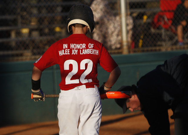 Cristian Dugger approaches home plate to take his turn at bat while honoring the memory of Hailee Joy Lamberth, the little girl who committed suicide as a result of being bullied, at the Arroyo Gr ...
