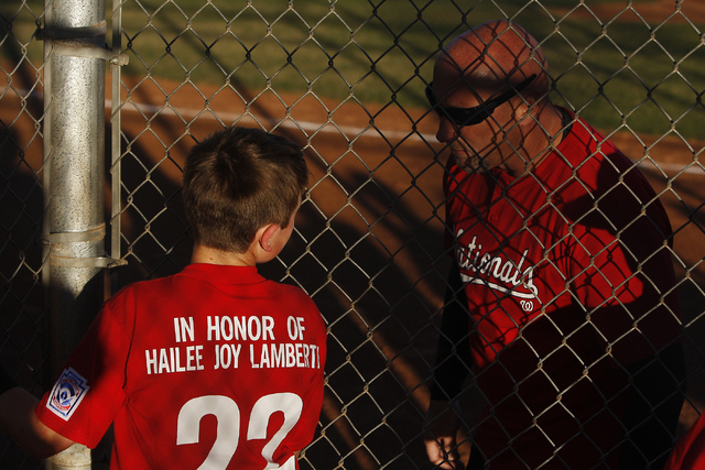 Cristian Dugger (22), of the Green Valley Nationals, talks to his dad and coach Travis Dugger while playing a baseball game at the Arroyo Grande Sports Complex in Henderson on April 1, 2014. Dugge ...
