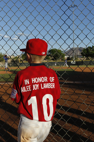Jaxon Nickels and his Green Valley Nationals little league teammates honor the memory of Hailee Joy Lamberth, the little girl who committed suicide as a result of being bullied, while playing a ba ...