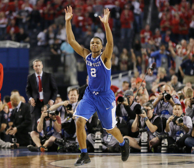 Kentucky guard Aaron Harrison celebrates after making a three-point basket in the final seconds against Wisconsin to win the game 74-73 during their NCAA Final Four tournament college basketball s ...