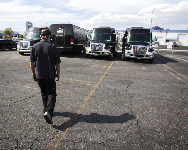 Norm Bemister  shop manager for AWG Ambassador, walks in the company's lot at W. Tompkins Avenue and Valley View Road on Friday, April 25, 2014.  There have been reports of escalating vandalism ag ...