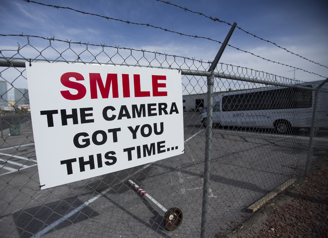 A sign as seen Friday, April 25, 2014 at  AWG Ambassador  at W. Tompkins Avenue and Valley View Road. The company has stepped up security since their vehicles have been shot with pellet guns. Ther ...